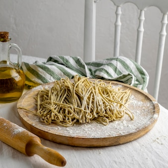 High angle noodles on wooden board