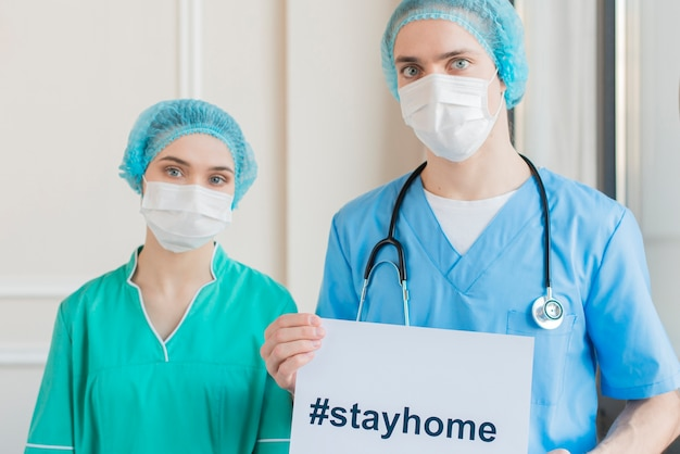 High angle nurses with stay home message