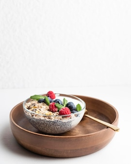 High angle of oatmeal bowl with raspberries and copy space