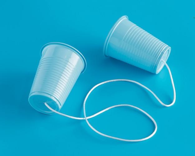 Высокий угол наклона бумажных стаканчиков с ниткой
