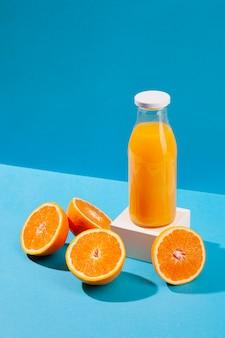 High angle orange juice bottle