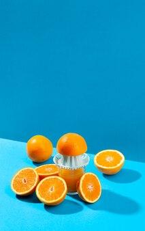 High angle orange and juice maker