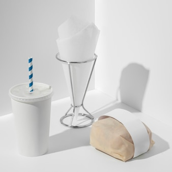 High angle packaged burger with blank cup and tissue holder