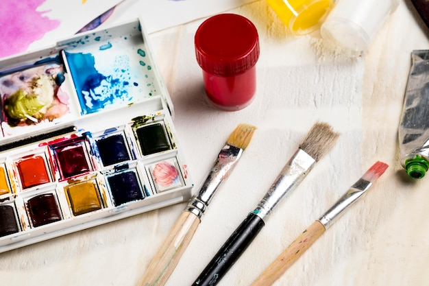 High angle of paint brushes and palette