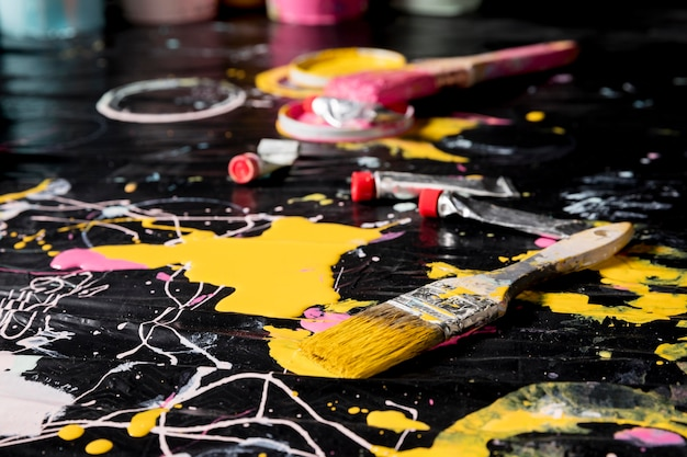 High angle of paint brushes with paint