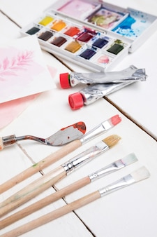 High angle of painting essentials with palette