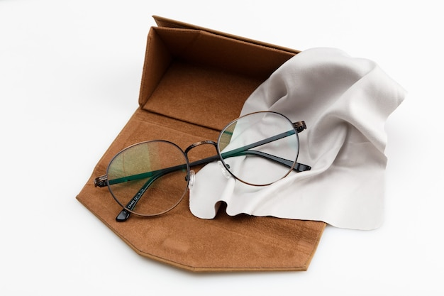 High angle of pair of glasses in case with copy space