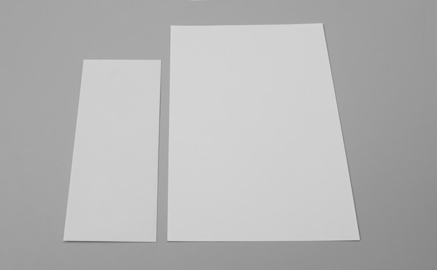 High angle paper sheets on grey background