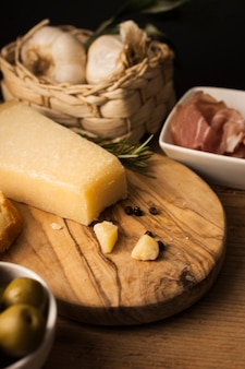 High angle parmesan with garlic and prosciutto