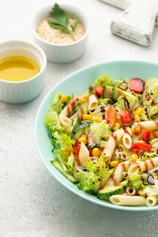 High angle pasta salad with balsamic vinegar, sesame seeds and oil