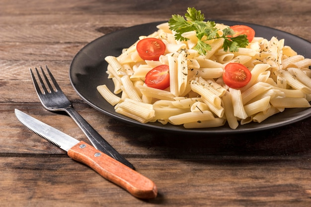 High angle pasta on wooden table