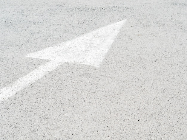 High angle of path arrow on asphalt