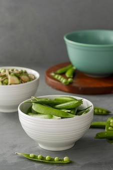 High angle pea pods in bowl