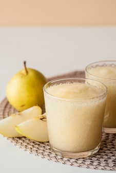 High angle pear smoothie in glass