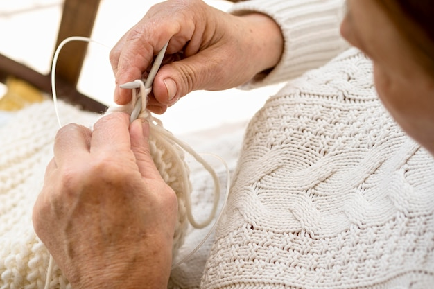 High angle of person crocheting with yarn