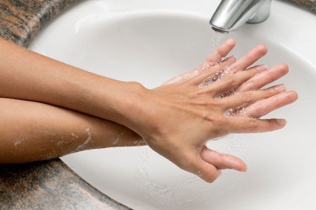 High angle person washing hands