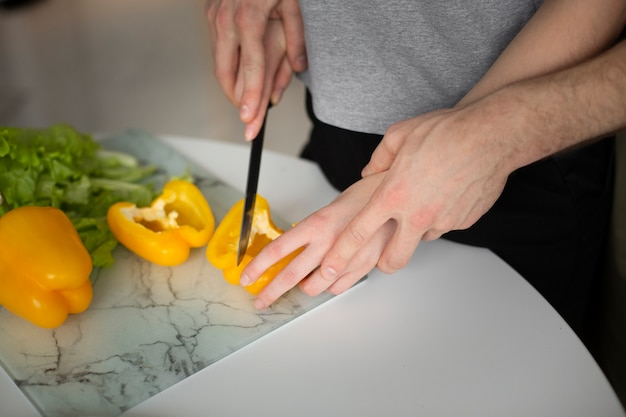 High angle pf couple cutting vegetables together