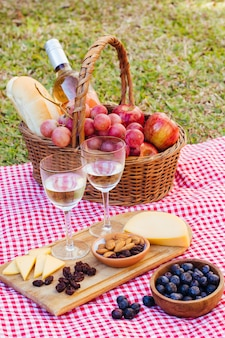 High angle picnic goodies for two with glasses of wine