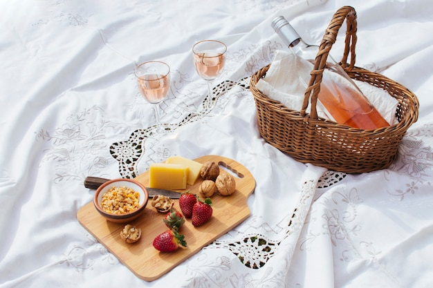 High angle picnic goodies on white sheet
