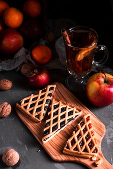 High angle of pie slices with tea