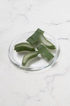 High angle of pieces of aloe vera on marble background