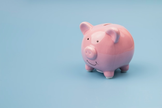High angle piggy bank on blue background