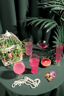 High angle pink drinks and girly ornaments