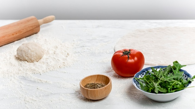 High angle pizza dough and ingredients