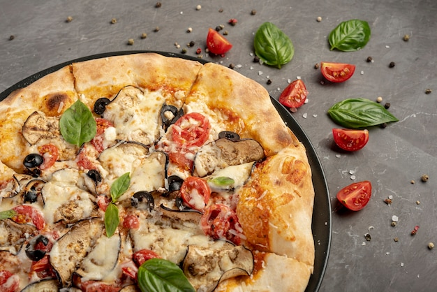 High angle of pizza on plain background