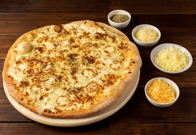 High angle pizza with cheese mix and dried herbs