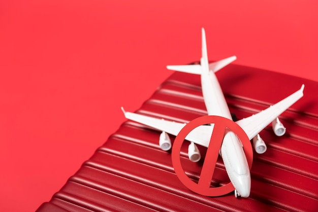 High angle plane on red luggage
