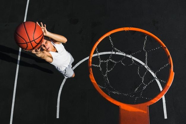 High angle of player throwing basketball