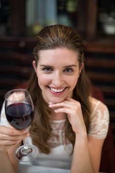 High angle portrait of happy woman holding wine glass