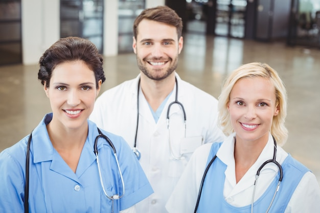 High angle portrait of smiling doctors and nurse