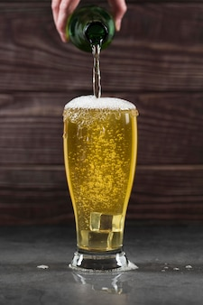High angle pouring beer in glass