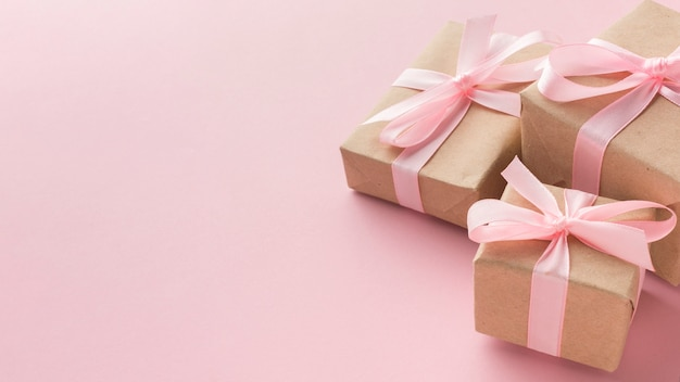 High angle of presents with pink ribbon