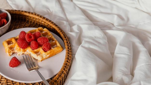 High angle raspberry waffle on plate