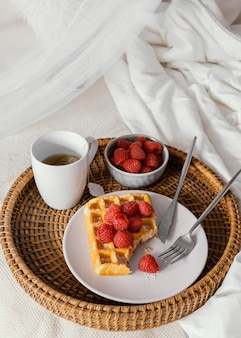 High angle raspberry waffle and tea