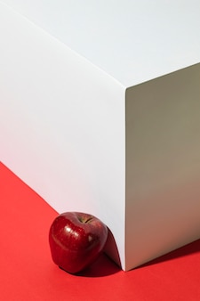 High angle of red apple next to podium