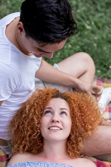 High angle red hair woman looking at her boyfriend
