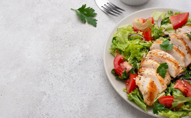 High angle salad with chicken and copy-space