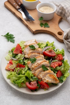 High angle salad with chicken, sesame seeds and oil