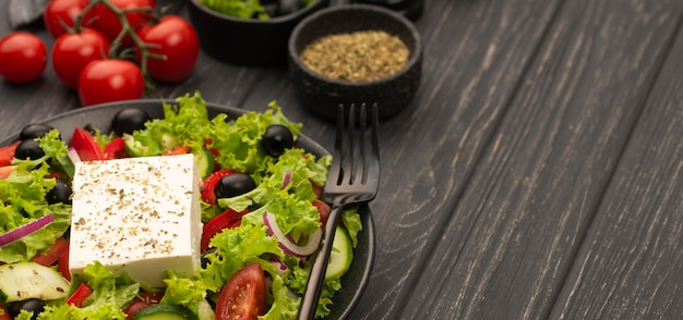 High angle salad with feta cheese, tomatoes and herbs