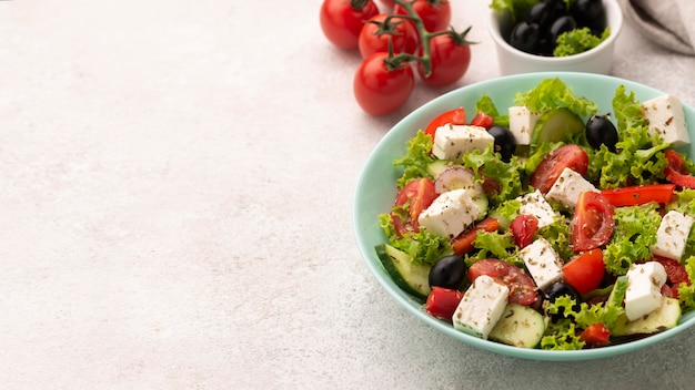 High angle salad with feta cheese, tomatoes and olives with copy-space