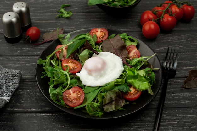 High angle salad with fried egg