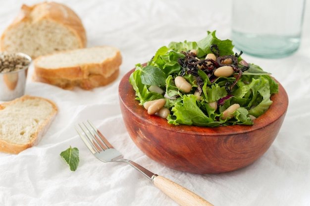 High angle salad with white beans and bread