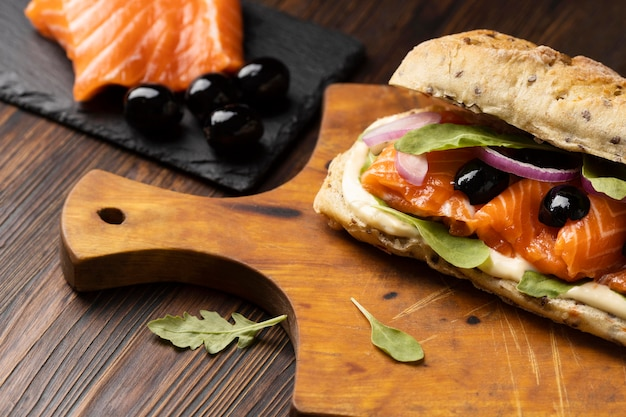 High angle of salmon and olives sandwich
