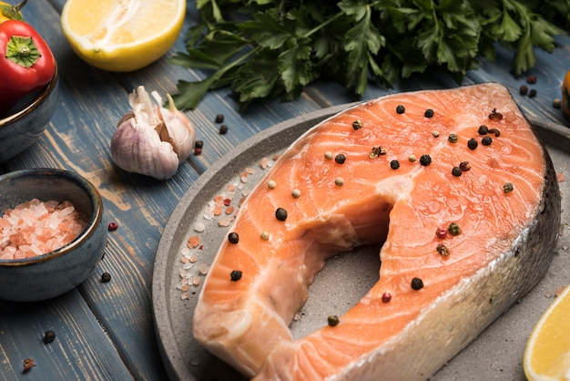 High angle salmon steak on tray with ingredients
