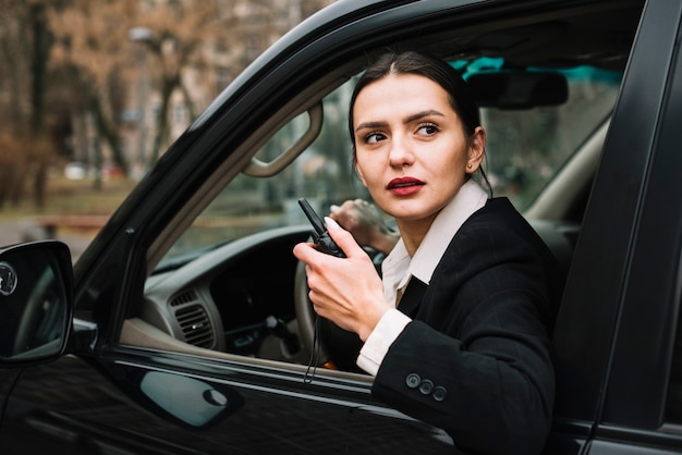 High angle security woman in car