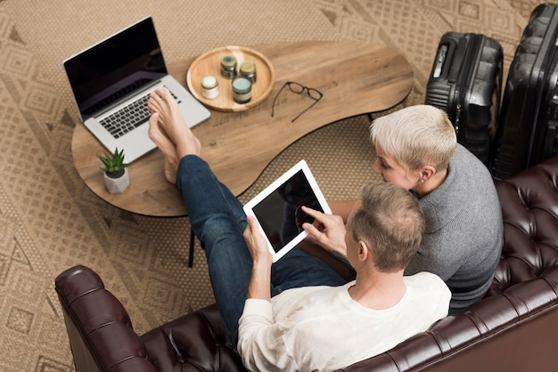 High angle senior couple looking on a tablet